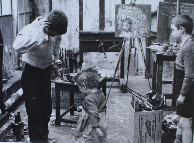 Local children in Joan Eardley's Townhead studio, Glasgow. Photo by Audrey Walker, Dumfriesshire Educational Trust, Gracefield Arts Centre, Dumfries