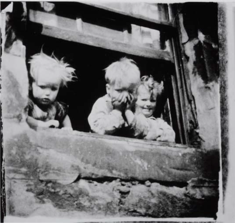 Photo by Joan Eardley of kids looking out a window. Can you see it as source material in two of the paintings on the National Galleries website?