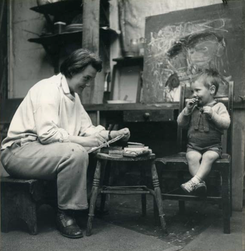 Photo of Joan Eardley drawing a child. Photo by Audrey Walker