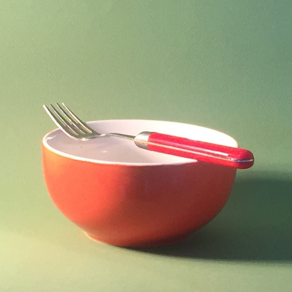 White Paper blog: The set-up of bowl and fork on a green background
