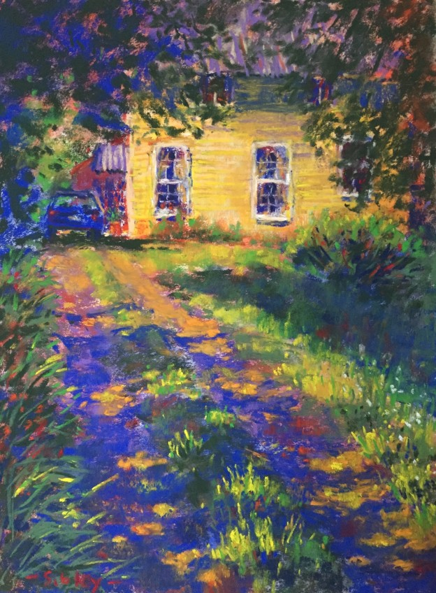 """En Plein Air: Another pondering. Even with all the lit grasses in lower part of the painting I felt the eye was still held by the house. So I softened the detailing of the siding and slightly greyed part of the yellow by glazing with light blue. Later I added the mauve to the upper portion of the wallto encourage the eye to move down. I also felt the third window kept your attention too much. I tried darkening it but in the end, decided to cover it with tree branches! After working at a few other bits and pieces, I signed it! Gail Sibley, """"The Old Creamery,"""" Schminke pastels on Wallis paper, 12 x 9 in"""
