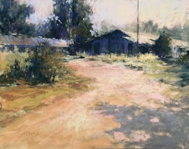 "Nancy Nowak, ""Out In the Sticks,"" pastel on UArt 400, 11 x 14 in. This scene is from the north Georgia mountains, along a side street, literally out in the sticks. I purposely used a limited palette of blues and its complementary color of light orange-ish color."