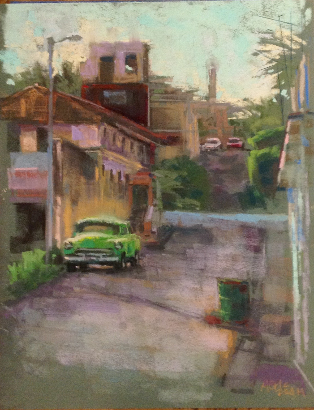 "Nancie King Mertz, ""Cojimar Car,"" 2016, plein air soft pastel on mounted Wallis paper, 14 x 11 in. I was very lucky to spend 6 days in Cuba along with 99 others, hosted by Plein Air Magazine. We were the first group of painters to flood the streets and had a blast painting this colorful culture. There were only 2-3 of us working in pastel and many of the oil painters envied our easy setup! I did 11 plein air works while there. This was painted in the fishing village where Hemingway lived while in Cuba."