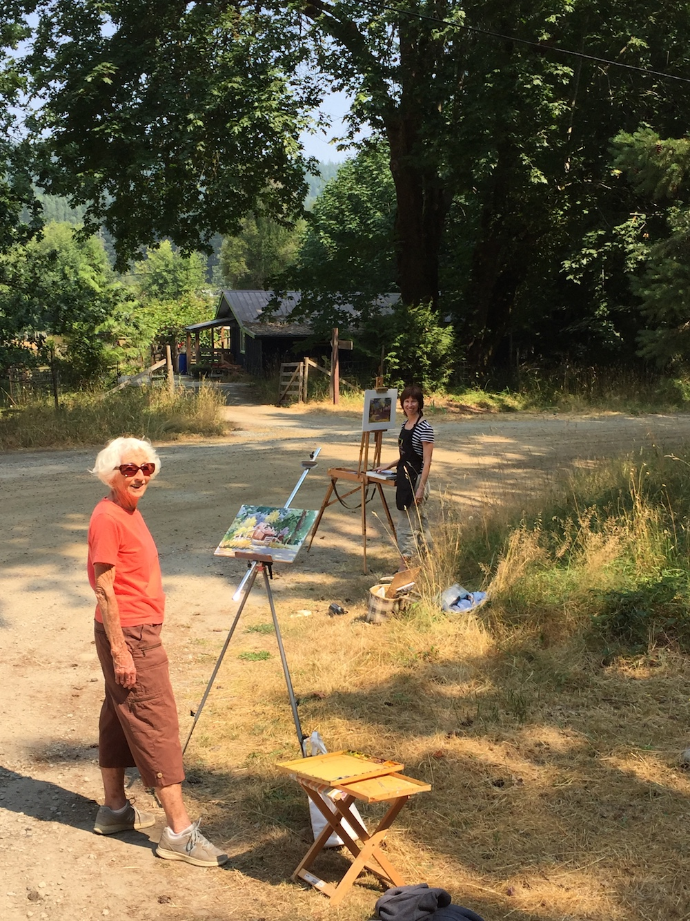 Tweaking a plein air painting in the studio: Dad snapped a photo of me and Mum at work. (Mum was working at watercolour.)