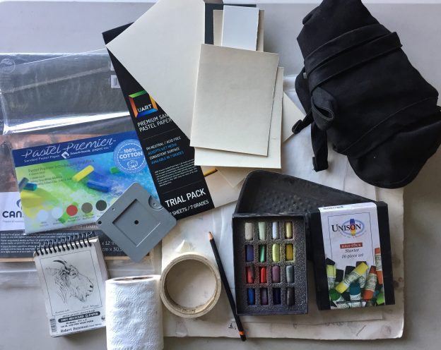 small box of pastels: Here's everything I took with me in my carry-on suitcase.