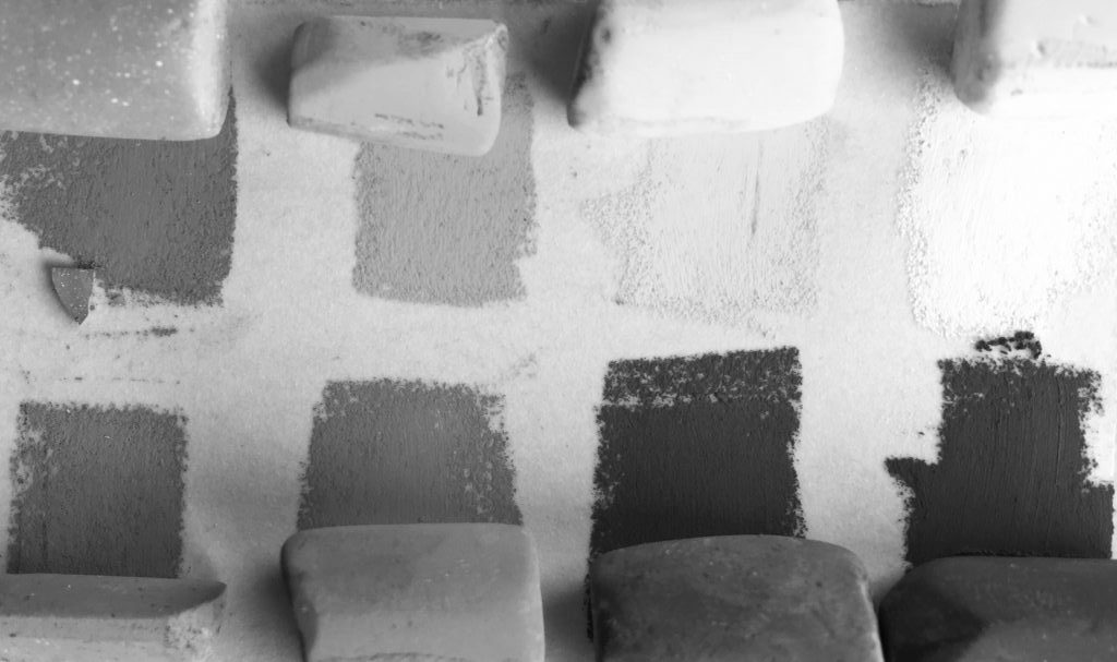 Painting a white object with colour: The eight colours shown in black and white - you can see very clearly the only two light colours.