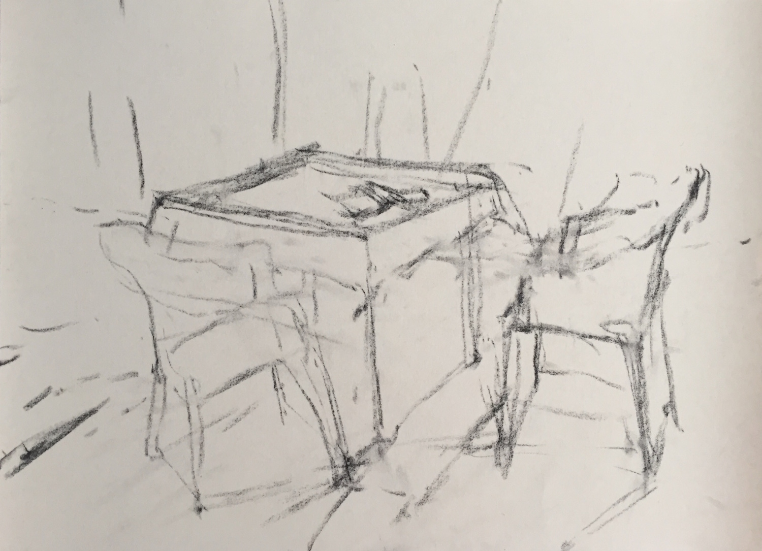 Chaos of Light And Shadow: 2. A quick placement of the main items of table and chairs, trying to get at least some correctness of perspective. Vine charcoal on UART 400.